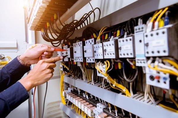 domestic electrician repairing control panel