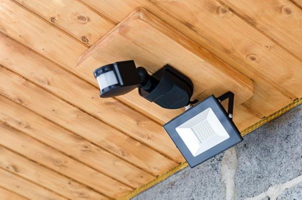 motion sensor security lighting on outside wall