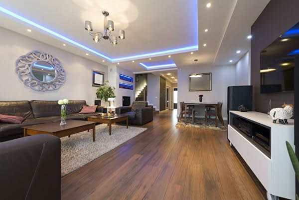 sitting room with ceiling light fixture and spotlights