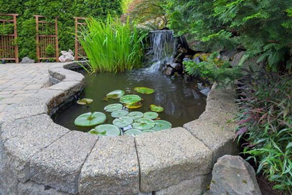 garden pond with water feature installation
