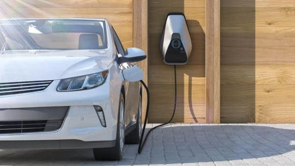 EV charging point recharging a parked car outside